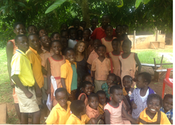 Kara Holbrook with students in village after promising them Village Dreams would help their parents build a new school.